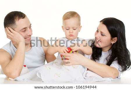 Beautiful Caucasian family of three on a light background