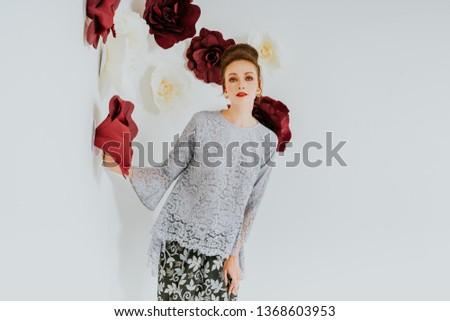 Beautiful caucasian female model wearing Baju Kebaya (Malay traditional dress) isolate over white background.Asian Female dress for Eid ul Fitr celebration or formal event. #1368603953