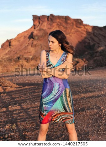 Beautiful caucasian girl in cosmic dress on the red planet . Unique landscape. Creative concept of the uniqueness, creativity. Be yourself message