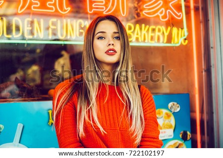Beautiful caucasian girl with red lips makeup in asian district.