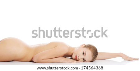 Beautiful caucasian naked woman lying down Isolated on white