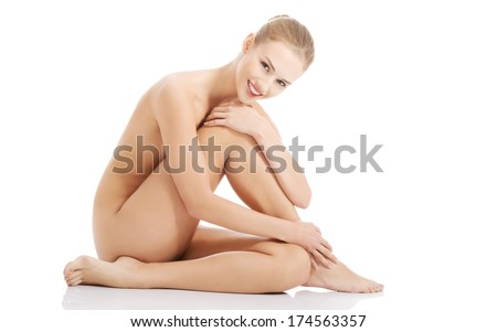 Beautiful caucasian naked woman sitting with fresh clean skin Isolated on white