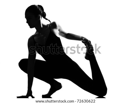 beautiful caucasian tall woman ballet dancer stretching warming up full length on studio isolated white background