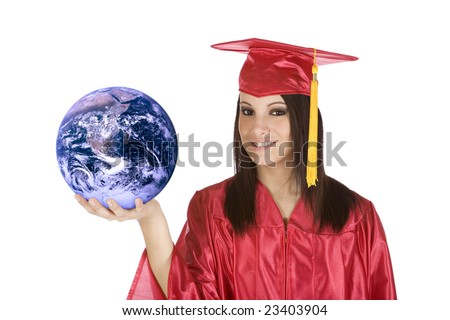 Beautiful Caucasian teenager in a graduation gown holding the world