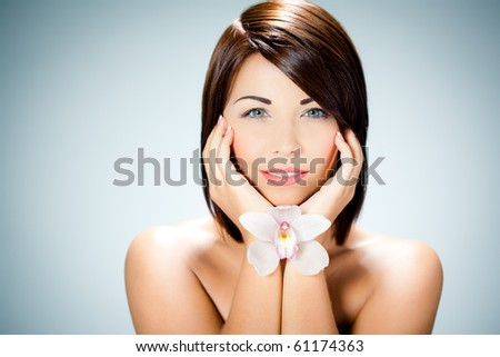 Beautiful caucasian woman and orchid
