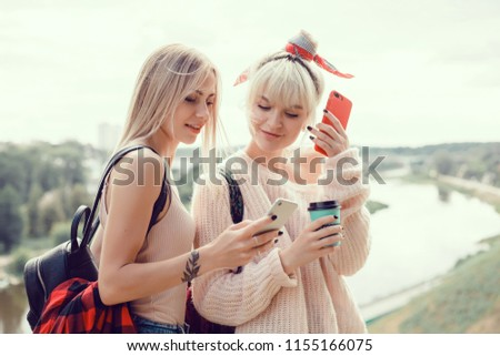 Beautiful Caucasian woman dreaming about something while sitting with portable net-book in modern cafe bar, young charming female freelancer thinking about new ideas during work on laptop, make selfie