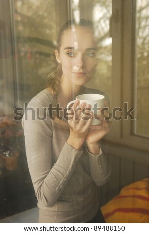 beautiful caucasian woman drinking coffee #89488150