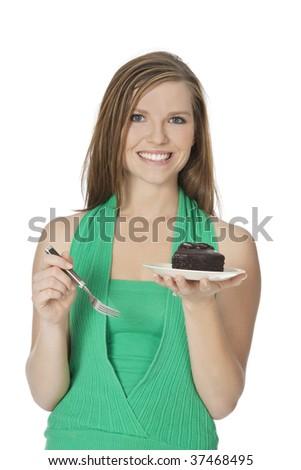 Beautiful Caucasian woman eating a slice of chocolate cake