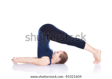 Beautiful Caucasian woman in blue Capri and top doing halasana, plough pose at white background. Free space for text