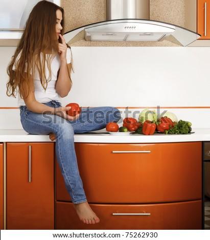 beautiful caucasian woman in the kitchen