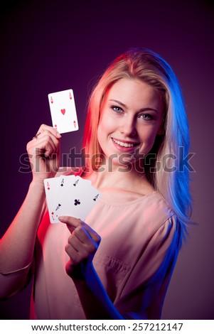 Beautiful caucasian woman with poker cards gambling in casino