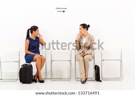 beautiful caucasian women chatting before employment interview