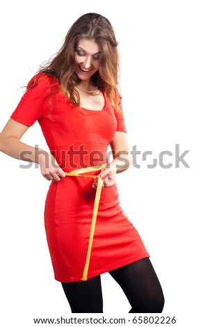 Beautiful caucasian women hold a tape measure and happy. Isolated on white background.