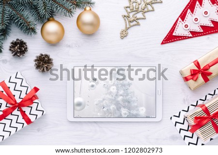 Beautiful celebratory Christmas background. New Year\'s holidays. Christmas holidays. Beautiful Christmas decorations on the wooden background. Loft style. Mockup