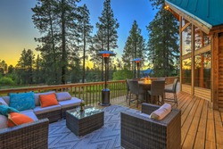 Beautiful chalet cider home exterior during evening with new deisgn outdoor furniture.