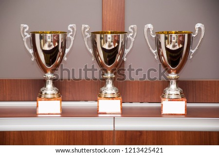 Beautiful champion golden cups for winners #1213425421