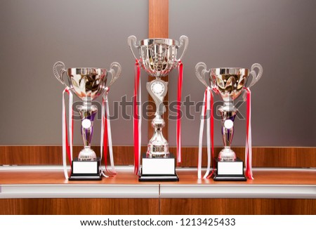 Beautiful champion golden cups for winners #1213425433