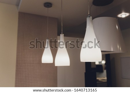 Beautiful chandelier. Modern chandelier hanging under ceiling.