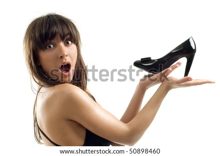 Beautiful charming model keeps in hand of the loafer on white background is insulated