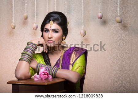 beautiful charming traditional indian bride, woman in indoor lighting  #1218009838