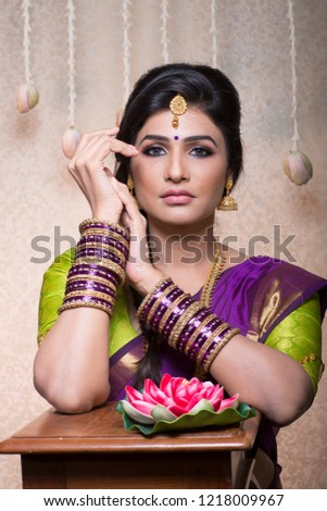 beautiful charming traditional indian bride, woman in indoor lighting  #1218009967