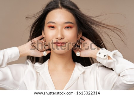 Beautiful charming woman studio fashion luxury cosmetics charm