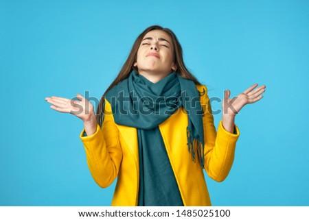 Beautiful charming woman yellow coat charm lifestyle model