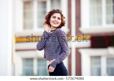 beautiful charming young girl posing for the camera. smiling