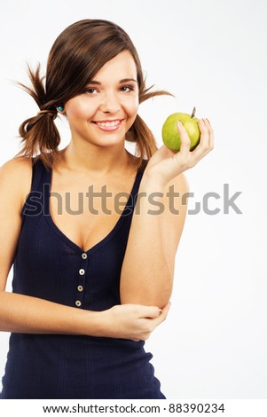 Beautiful cheerful girl with a green apple