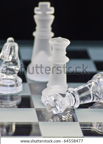 Beautiful chess pieces on black background with stunning color and definition