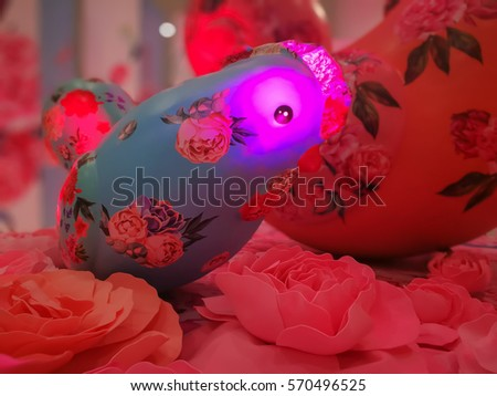 Beautiful chicken doll on the roses flower. Valentine sweet background. #570496525