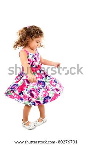Beautiful Child girl dancing on studio .