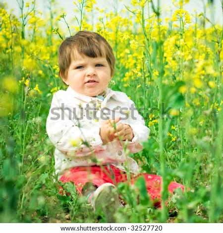 beautiful child in canola field