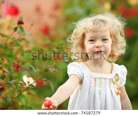 Beautiful child in summer garden