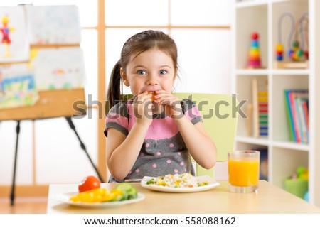 Shutterstock Beautiful child kid girl drinking healthy food