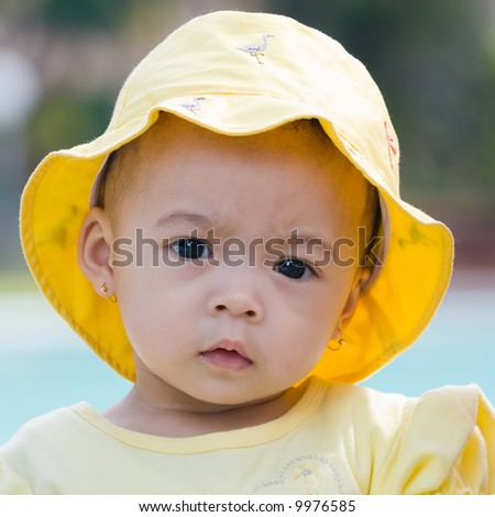 beautiful child wearing yellow hat