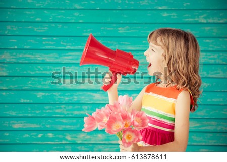 beautiful child with bouquet of ...