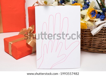 Beautiful children's card with the handprint of an adult parent of a mother or father and a child. Happy Family Day.