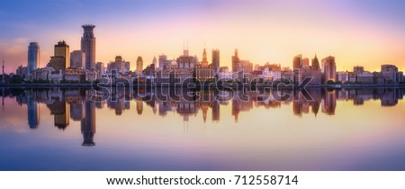 Beautiful chinese cityscape of Shanghai's skyline with the city lights and tower on the Huangpu River bay, Shanghai, China. #712558714