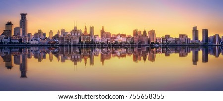 Beautiful chinese cityscape of Shanghai's skyline with the city lights and tower on the Huangpu River bay, Shanghai, China. #755658355
