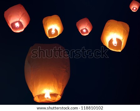 Beautiful chinese sky lanterns floating in the sky on occassion of an Indian festival.