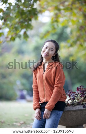 Beautiful Chinese student in campus in fall season