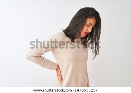 Beautiful chinese woman wearing turtleneck sweater standing over isolated white background Suffering of backache, touching back with hand, muscular pain