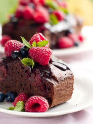 Beautiful chocolate cake with fresh berry. Selective focus