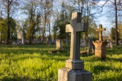 beautiful christian stone cross in an old forgotten cemetery, charming place, crosses, graveyard in spring