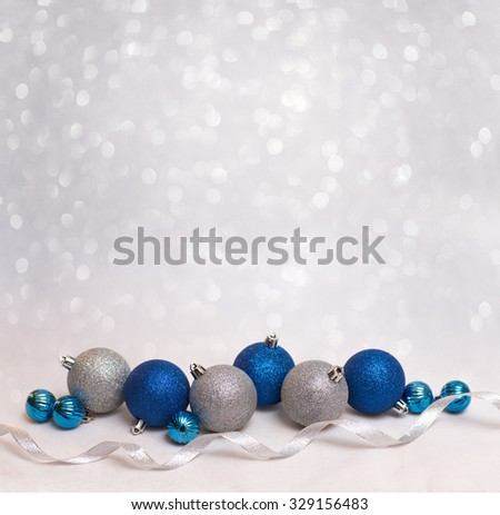 Beautiful Christmas background with blue and white christmas balls for xmas design