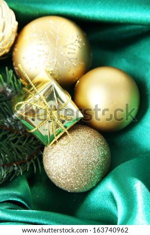 Beautiful Christmas decor on green satin cloth