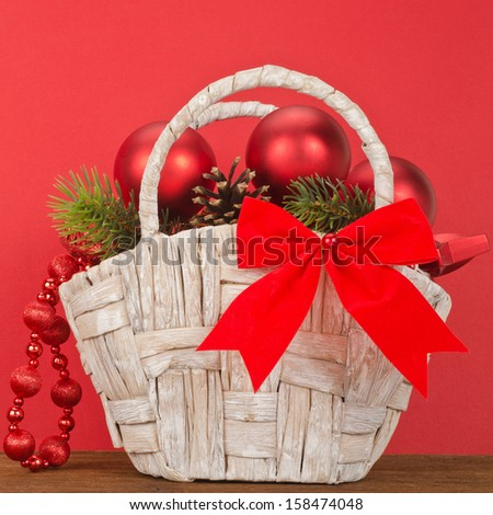 Beautiful Christmas Gift Basket on red background