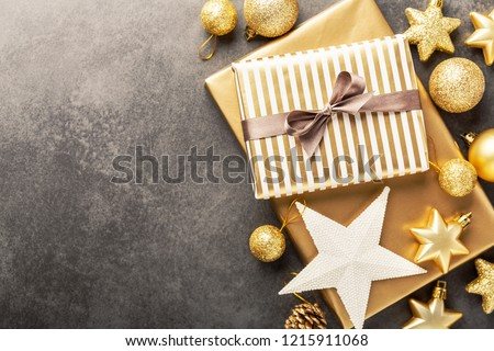 Beautiful christmas golden silver deco baubles and gifts on grey background. Flat lay design. Copy Space. Horizontal. #1215911068