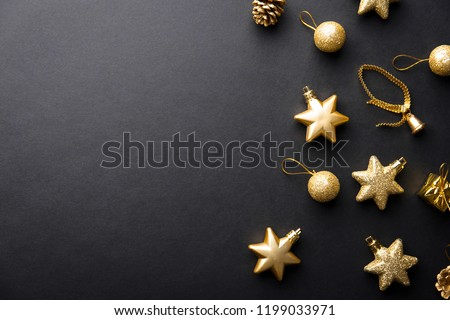Beautiful christmas golden silver deco baubles on dark black background. Flat lay design. Copy Space. Horizontal. #1199033971